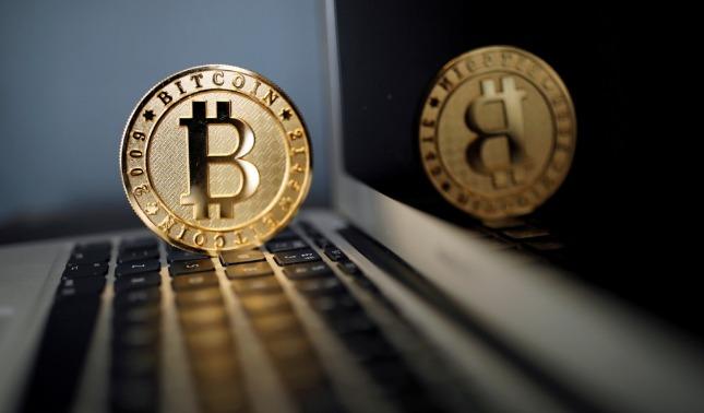 rceni - Divisa virtual bitcoin - supera- los- 18.000- y- se -acerca- a- su- récord- histórico-